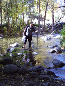 Jeff wading in the creek