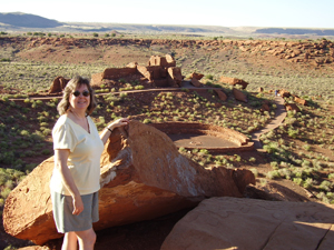 Linda-Ann Stewart in front of the ball court at Wupatki National Monument